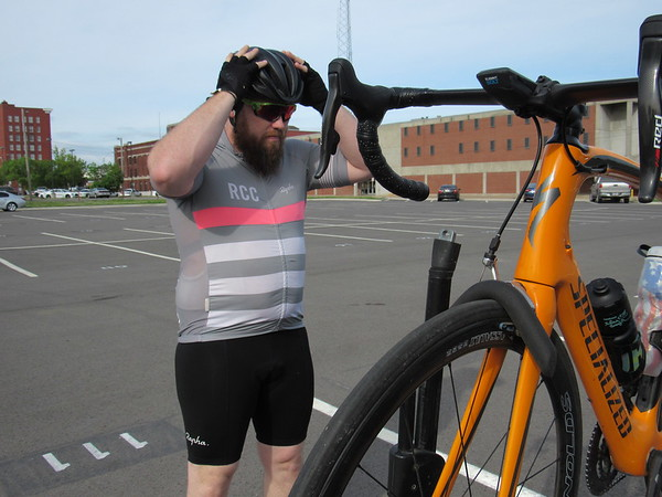 Jonathan Hawke adjusts his bicycle helmet before getting his bike off the stand. He is involved in the Muskogee Area Cycling Facebook Group.