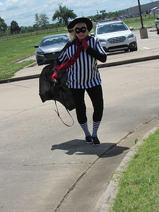 CATHY SPAULDING/Muskogee Phoenix Third-grade teacher Shawn Dickmann, dressed as the Hamburglar, returns to the Intermediate Elementary campus after distributing Happy Meals to her students Friday.
