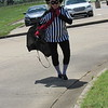 CATHY SPAULDING/Muskogee Phoenix<br /> Third-grade teacher Shawn Dickmann, dressed as the Hamburglar, returns to the Intermediate Elementary campus after distributing Happy Meals to her students Friday.