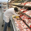 RONN ROWLAND/Muskogee Phoenix<br /> John Morrison replenishes some of the meat on the shelf at Mini Max on East Shawnee Bypass. Leonard Lee, the meat specialist for the store, says he has an ample supply of product ready for his customers.