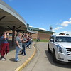 CATHY SPAULDING/Muskogee Phoenix<br /> Intermediate Elementary students poke out of a sport utility vehicle roof to wave to teachers on the final day of the school year Friday. They had to keep their distance out of concern for COVID-19.