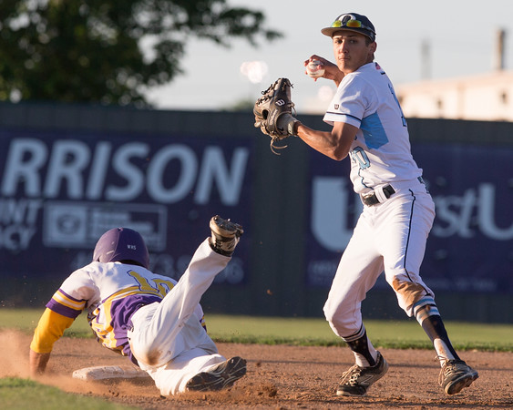 Special photo by Von Castor<br /> Oktaha's Zach Evans completes a double play as Wister's Kolton Lynn slides into second base in a Class 2A quarterfinal game at Memorial Stadium in Shawnee. Wister scored eight runs on no hits, two errors and five walks in the fifth inning to claim a 14-4 win.