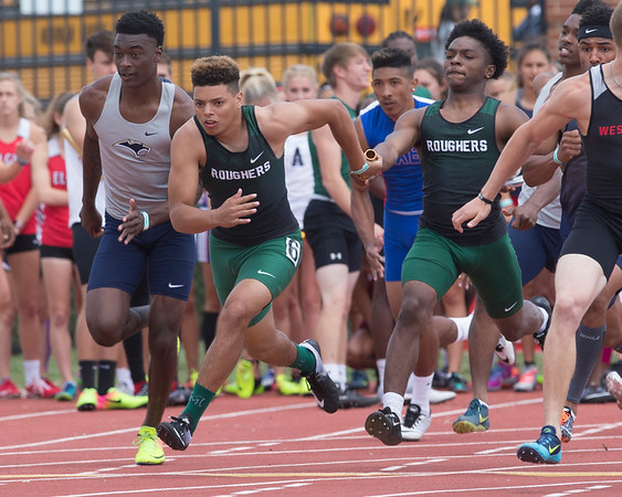 Phoenix special photo by Von Castor<br /> Muskogee's Kobe Green, right, hands off to Diante Crutchfield in the final leg of the boys 400-meter relay Friday during the Class 6A track meet in Yukon.