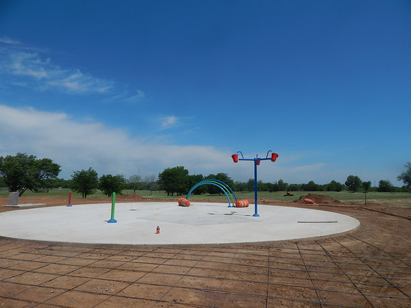 KENTON BROOKS/Muskogee Phoenix<br /> Work is ongoing on the new splash pad at the Checotah Sports Complex. The pad is expected to open Friday.