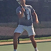 MIKE KAYS/Muskogee Phoenix<br /> Wagoner's Austin Condict returns a volley during Saturday's singles action in the Class 4A state tournament.