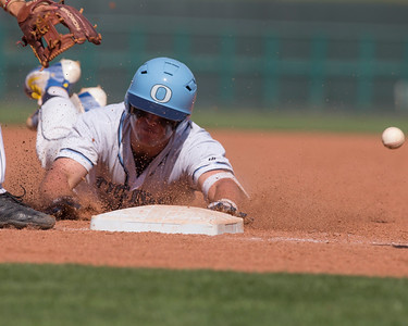 VON CASTOR/Special to the Phoenix Oktaha's Matt Erwin slides into third base after doubling and advancing on a error in the sixth inning of Saturday's Class 3A championship game against Jones at Bricktown Ball Park in Oklahoma City.