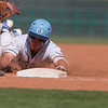 VON CASTOR/Special to the Phoenix<br /> Oktaha's Matt Erwin slides into third base after doubling and advancing on a error in the sixth inning of Saturday's Class 3A championship game against Jones at Bricktown Ball Park in Oklahoma City.