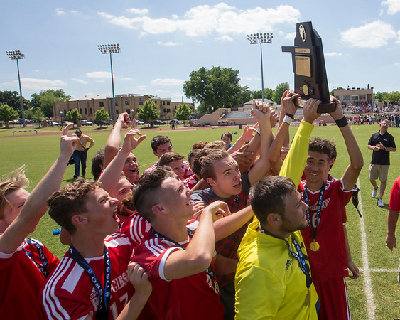 Special photo by Von Castor<br /> Members of the Fort Gibson soccer team hold up the Class 4A state championship trophy after defeating Sante Fe South 1-0 in sudden death overtime Saturday afternoon at Tulsa University.