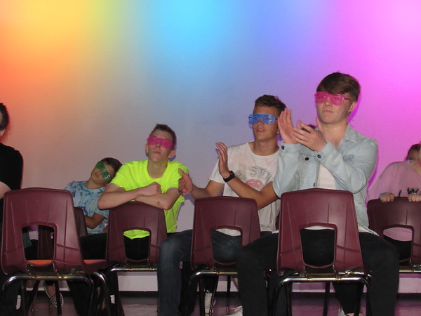 CATHY SPAULDING/Muskogee Phoenix<br /> Fort Gibson High School performers show some neon flash as they sing a 1980s mash-up for the Tiger Revue.