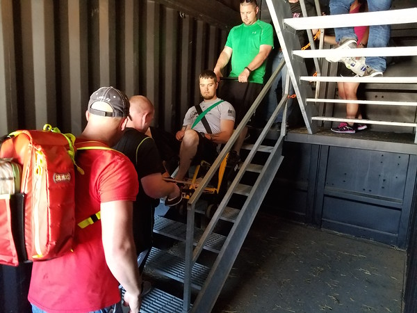 Staff photo by Mark Hughes<br /> J.T. Morgan is carried down stairs in a stair chair by Bobby Hayes and Gavin Wood as part of training at the First Responder Training Center. Nine emergency medical technicians are enrolled in the nationwide mandatory advanced emergency medical technician course at Muskogee County Emergency Medical Service.