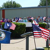 Staff photo by Mark Hughes<br /> Dozens of people attend the somber ceremony Saturday of The Tolling of the Boats at Muskogee's War Memorial Park. The event was a remembrance of the 65 submarines lost since the beginning of the Navy submarine service in 1900. The name of each ship was called out as the bell tolled.