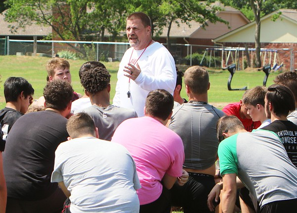 JOHN HASLER/Special to the Phoenix New Hilldale football coach Greg Werner addresses the team on the first day of spring practice on Monday. Werner replaced Chad Kirkhart who resigned in March after eight seasons.