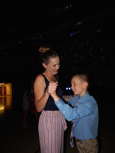 CATHY SPAULDING/Muskogee Phoenix Stephanie Howe slow dances with her son, Memphis Tiner, 9, during Friday's Mother Son Dance at Intermediate Elementary School gym.