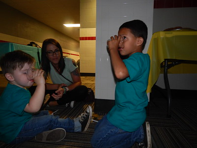 CATHY SPAULDING/Muskogee Phoenix Kiley Jones takes a snack break with her sons, Eli, 2, left, and Jackson, 5, at the Mother Son Dance, held Friday. Frank Gladd American Legion Post 20 held the dance.