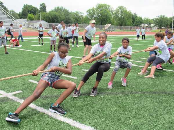 Staff photo by Cathy Spaulding<br /> Cherokee Elementary students, including, from left, Makya Winfrey and Denise Bowler, tug and pull while competing in a tug of war. Muskogee Public Schools elementary students ran, jumped and tugged their way through the annual Elementary Track Meet, held Monday at Indian Bowl stadium.