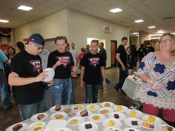 Staff photo by Cathy Spaulding<br /> Fort Gibson High School band members, from left, Jon Dallis, Lauren Karnes and Jayden Bassi discuss dessert options at the Ice Cream Social and band concert. Karnes said she used the small plunger as a mute for her trumpet in a jazz band number.
