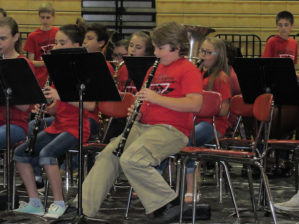 Staff photo by Cathy Spaulding<br /> Gabe Heidbreder plays clarinet with the Fort Gibson sixth-grade band Thursday during the Ice Cream Social and bands concert.