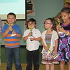 """CATHY SPAULDING/Muskogee Phoenix<br /> Pershing Elementary kindergarteners, from left, Jayse Boyd, P.J. Snow, Nevaeh Keeton and Eva Hall relish receiving trophies for placing first in the Muskogee Public Schools Drug-Free Video contest. They won with """"Hug a Pug."""""""