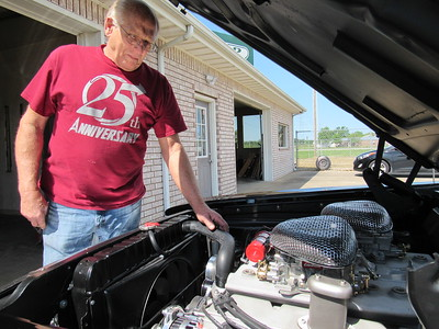 CATHY SPAULDING/Muskogee Phoenix A HEMI engine adds power to Larry Tripp's 1962 Dodge Dart, which he has entered in Saturday's Cruis'n Angels Car Show.