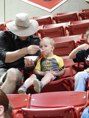 Staff photo by Cathy Spaulding<br /> Josh McDonnell feeds his 11-month-old son, Josiah, a spoonful of ice cream during Fort Gibson's annual ice cream social and band concert Thursday.