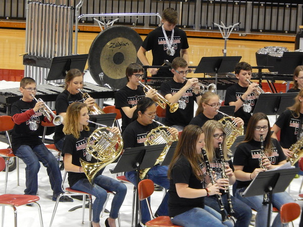 Staff photo by Cathy Spaulding<br /> Fort Gibson Middle School band members play trumpets, French horns, clarinets, and percussion during the annual band concert and ice cream social Thursday. The social helps raise money for band programs.