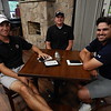 NATHAN DEAL/Phoenix Staff Photo<br /> At the table, from left, APT golfers Andrew Buchanan, Daniel Miernicki and Patrick Simard wait out the rain on Wednesday at Muskogee Golf & Country Club. A late morning storm system forced cancellation of play.