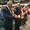 CHESLEY OXENDINE/Muskogee Phoenix<br /> Muskogee Police Department Deputy Chief Chad Farmer helps Chief Johnny Teehee light his vigil candle during a ceremony held Thursday for fallen police officers.