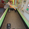 Staff photo by Cathy Spaulding<br /> Chance Pippin, a fifth-grader at Oktaha Elementary, arranges mirrors on a plane to see how to get a laser beam to the other side. Chance and his classmates visited the Science Matters Mobile Museum on Tuesday. Oktaha fifth-graders learned about lasers, mirrors, motion, magnetism and other wonders during a Tuesday visit to the Science Matters Mobile Museum. The mobile museum came to Indian Capital Technology Center's Muskogee campus. The Oklahoma Museum Network, with funding from the Donald W. Reynolds Foundation, presents the museum to help children get interested in science, technology, engineering and math.