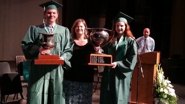 Staff photo by Cathy Spaulding<br /> Muskogee High School Principal Dawna Buck, center, stands with McEntee Award recipient Brenden Martin, left, and Stern Award recipient Bailey Tull.