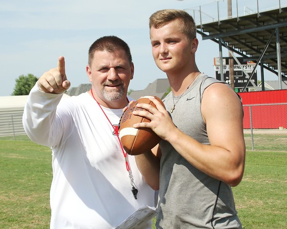 JOHN HASLER/Special to the Phoenix<br /> Hilldale head coach Greg Werner gestures during a moment in<br /> practice this week with quarterback Dawson Neighbors.