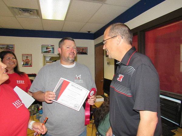 CATHY SPAULDING/Muskogee Phoenix<br /> Hilldale High School video production teacher Phil McWilliams, left, visits with Hilldale Superintendent Erik Puckett on Friday after the Hilldale Education Foundation awarded him with a $8,400 grant to enhance digital media.