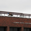 Staff photo by Cathy Spaulding<br /> A worker with BRB Roofing installs the frame of Fort Gibson Community Center's new roof. A gable roof is being installed at Fort Gibson Community Center. Town building inspector Joe Roark said the roof should be finished before July.
