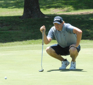 NATHAN DEAL/Muskogee Phoenix Daniel Miernicki studies a putt on the seccond green Friday during play in the Muscogee Creek Nation Casinos Real Okie Championship being played at Muskogee Golf and Country Club. For today's tee times, go to https://bit.ly/2ka9Lw8