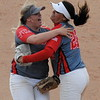 MIKE KAYS/Muskogee Phoenix<br /> Fort Gibson's Abbi Scott, left, and Aubrey Bell celebrate after the Lady Tigers defeated Perkins-Tryon 12-9 in eight innings in the Class 5A state semifinals in Oklahoma City. Fort Gibson went on to run-rule Heavener 22-4 to win the program's first state title since 1999.