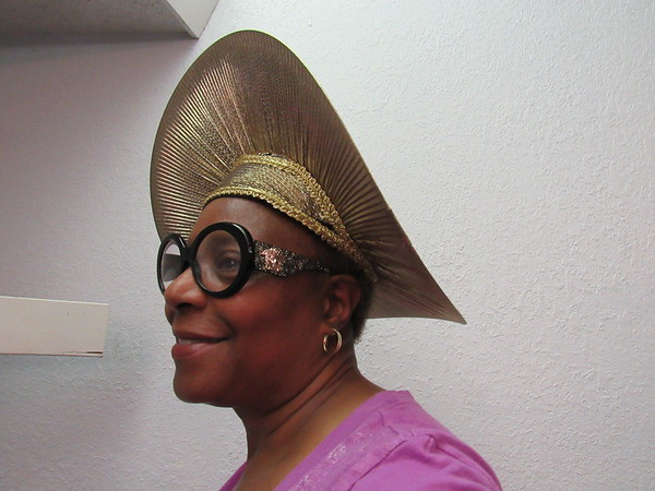 Staff photo by Cathy Spaulding<br /> Laura Wade, the president of St. Mark Baptist Church Pastor's Aid program, wears one of the hats to be modeled at the church's style show Sunday afternoon.