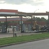 Staff photo by D.E. Smoot<br /> Workers on Friday morning remove the remnants of an awning that severe storms ripped from its steel skeleton at a fueling station and convenience store just north of the intersection at U.S. 69 and Oklahoma 51 in Wagoner.