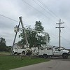 Staff photo by D.E. Smoot<br /> City of Wagoner Public Works employees replace utility poles damaged late Thursday night by thunderstorms that moved through eastern Oklahoma.