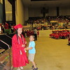 CATHY SPAULDING/Muskogee Phoenix<br /> Andy Jiang, 7, jumps to greet his big sister, Shuxian Jiang after received her diploma during Hilldale High School's commencement ceremony Saturday.