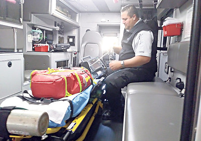 RONN ROWLAND/Muskogee Phoenix Muskogee County Emergency Medical Service medic Johnny Alberty inspects some equipment on board one of the ambulances at the Muskogee County EMS station. Gov. Kevin Stitt signed Senate Bill 1290 into law on Tuesday protecting health care workers, including EMS workers, from violent acts in the workplace.