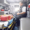 RONN ROWLAND/Muskogee Phoenix<br /> Muskogee County Emergency Medical Service medic Johnny Alberty inspects some equipment on board one of the ambulances at the Muskogee County EMS station. Gov. Kevin Stitt signed Senate Bill 1290 into law on Tuesday protecting health care workers, including EMS workers, from violent acts in the workplace.