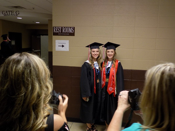 Special photo by Mike Elswick<br /> Hilldale High School graduates Megan Crow, right, and Shelby McGlothlin were the center of attention as they pose for family photos Saturday afternoon before graduation exercises began.