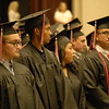 Special photo by Mike Elswick<br /> Classmates stand while awaiting their turn to receive diplomas Saturday during Hilldale High School's 2017 graduation exercises at Muskogee Civic Center.