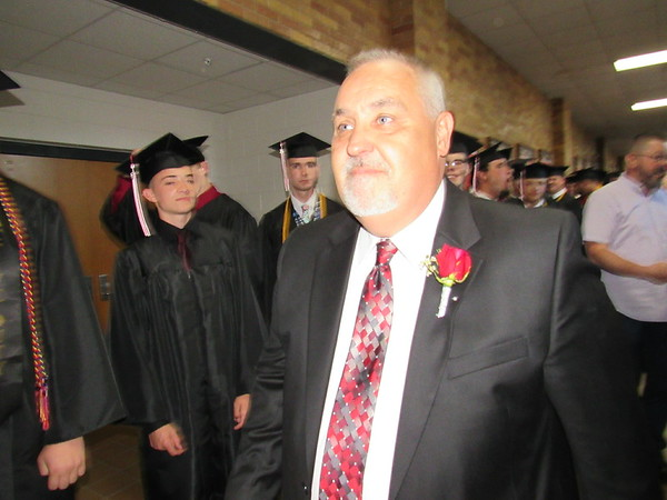 Retiring Fort Gibson High School Principal Gary Sparks passes FGHS seniors in a final review before Friday's graduation. Sparks had been principal for more than 20 years.