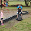 Staff photo by Mark Hughes<br /> Aubrey Romine, 5, points out trash to Broc Fletcher, 7, during Saturday's cleanup on the five-acre campus at Hilldale Elementary School. After the cleanup, participants planted flowers and a Harvest Gold Crabapple tree.
