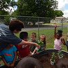KENOTN BROOKS/Muskogee Phoenix<br /> Pre-kindergarten teacher Brandi O'Dell has her class smell plants as part of the Water Exploration Invitation to Play at the Muskogee Early Childhood Center on Monday. Children learned about water, plants and dirt as part of their lessons during the class.
