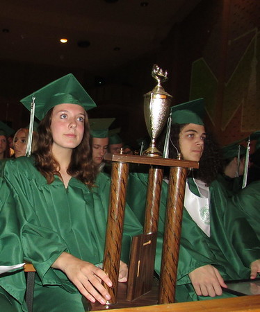 CATHY SPAULDING/Muskogee Phoenix<br /> Muskogee High School senior Meagan Henningsen balances an award on her lap during Monday's MHS Senior Awards program. Henningsen earned awards in math, English, history and broadcasting. Zion Diaz is to her right.