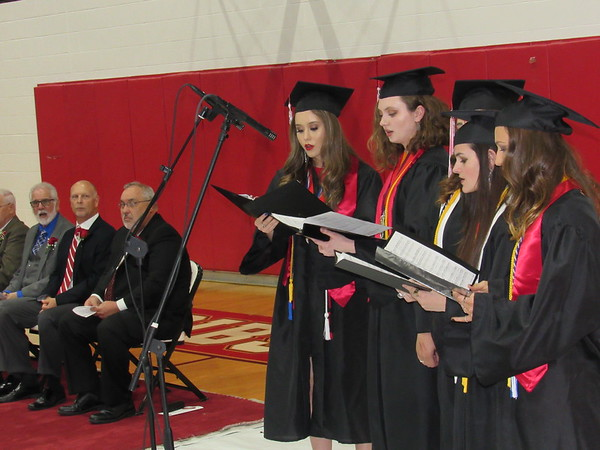 "CATHY SPAULDING/Muskogee Phoenix<br /> Fort Gibson High School's Class of 2018 celebrated commencement at the Fort Gibson gym Friday with music and honors. The class earned more that $3.5 million in scholarships. Members of a senior class ensemble sing ""Today My Life Begins""."