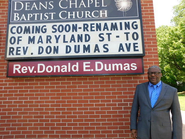 KENTON BROOKS/Muskogee Phoenix<br /> Rev. Donald Dumas stands before the sign that bears his name at Deans Chapel Baptist Church at 1119 S. Junction Ave. Later this month, more signs will be put in a four-block stretch on Maryland Ave. to be named Rev. Donald Dumas Ave. Dumas has been the pastor at the church for 37 years.