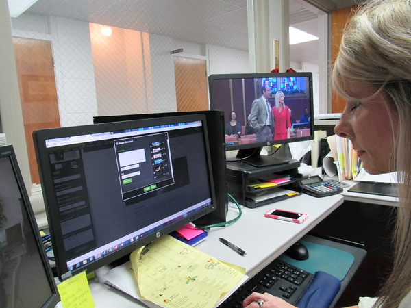 Staff photo by Cathy Spaulding Nikki Wallace uses information from the Eastern Heights Baptist Church newsletter to update the church's website. The monitor on the right shows her and her husband, Eastern Heights' pastor, Dr. Darren Wallace.