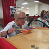 Staff photo by Cathy Spaulding<br /> Retiring Hilldale administrative staff member Sharon Mocha dings a toy xylophone to draw faculty attention during a Monday reception. The reception honored school retirees, site and district teachers of the year and Hilldale Education Foundation grant recipients.